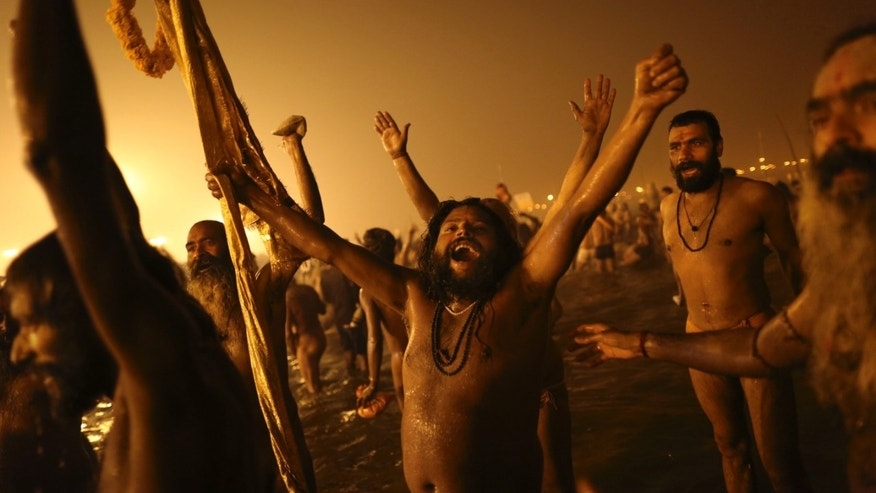 Jan. 14, 2013 - Indian Hindu holy men, or Naga Sadhus, celebrate naked in the water at the rivers Ganges during the royal bath on Makar Sankranti at the start of the Maha Kumbh Mela in Allahabad, India.