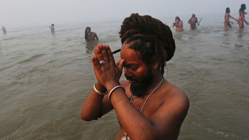 Jan. 14, 2013 - An Indian Hindu holy men prays at the Ganges river during the royal bath on Makar Sankranti at the start of the Maha Kumbh Mela in Allahabad, India.