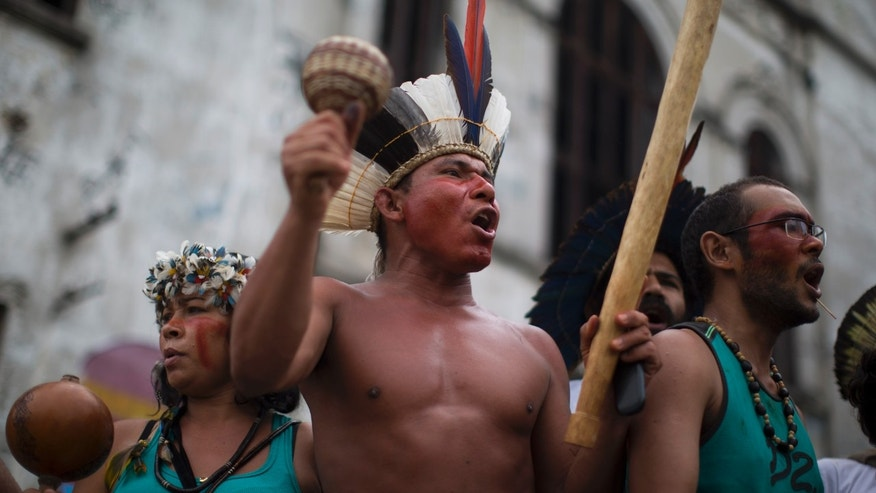 A group of indigenous people chants slogans on the grounds of an old Indian museum, in Rio de Janeiro, Brazil, Saturday, Jan. 12, 2013.