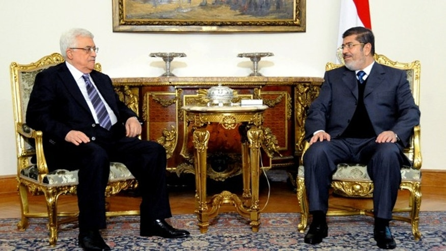 Jan. 9, 2013: In this image released by the Egyptian Presidency, Egyptian President Mohammed Morsi, right, meets with Palestinian President Mahmoud Abbas at the Presidential Palace in Cairo, Egypt.