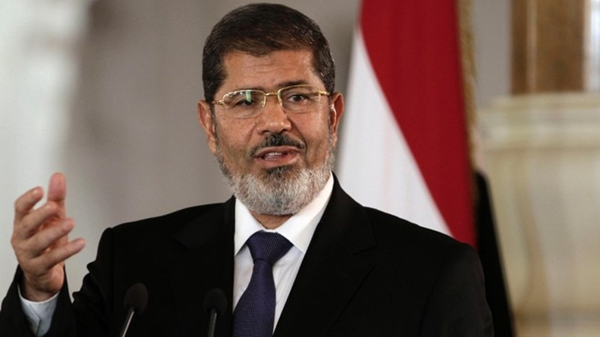 Critics fear Egyptian President Mohamed Morsi's regime is taking the nation further toward Islamic extremism. (AP)