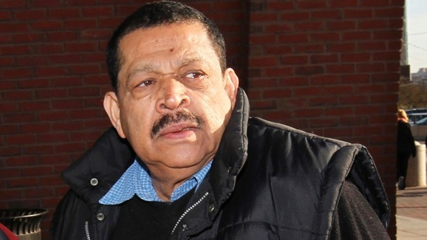 FILE - In this Dec. 19, 2011 file photo, Inocente Orlando Montano, a former Salvadoran military officer, arrives at federal court in Boston.  On Tuesday, Jan. 15, 2013, a federal judge in Boston delayed Montanoâs immigration fraud sentencing. Montano is accused of playing a role in the 1989 slayings of six Jesuits priests during his countryâs civil war. (AP Photo/Steven Senne, File)