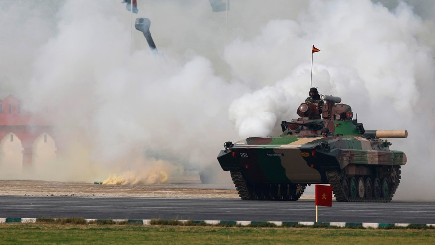 Indian army soldiers conduct a mock drill during an event to mark Indian Army Day in New Delhi, India, Tuesday, Jan. 15, 2013.  Indian Army Day is an annual event honoring the military. (AP Photo/Tsering Topgyal)