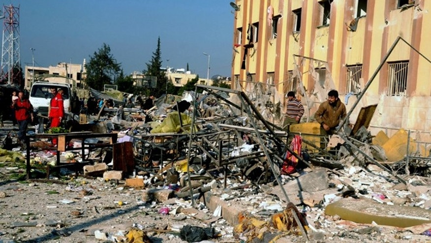 Jan. 15, 2013: In this photo released by the Syrian official news agency SANA, Syrian people gather at the site after an explosion hit a university in Aleppo, Syria.