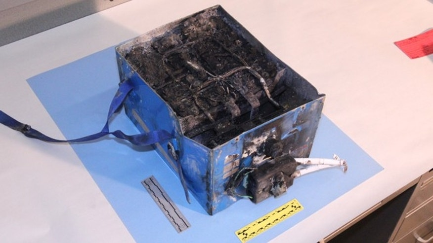 Jan. 7, 2013: This undated image provided by the National Transportation Safety Board shows the burned auxiliary power unit battery from a JAL Boeing 787 that caught fire at Boston's Logan International Airport.