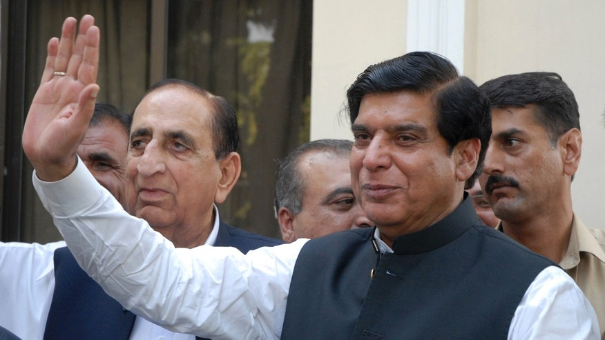 FILE -- In this Friday, June 22, 2012 file photo, Pakistan's Prime Minister Raja Pervaiz Ashraf waves in Islamabad, Pakistan. Pakistan's Supreme Court has ordered the arrest of the country's prime minister as part of a corruption case involving private power stations, officials said Tuesday, Jan. 15, 2013. (AP Photo/B.K. Bangash, File)