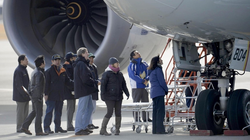 Jan. 18, 2013 - U.S. officials, center,  inspect All Nippon Airways jet which made an emergency landing Wednesday, at an airport in Takamatsu, Japan.