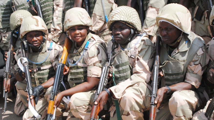 Nigeria battalion 1, troops for African led international support mission to Mali are seen before their departure at the peace keeping centre in Jaji, Kaduna, Nigeria, Thursday, Jan. 17, 2012. (AP Photo/)