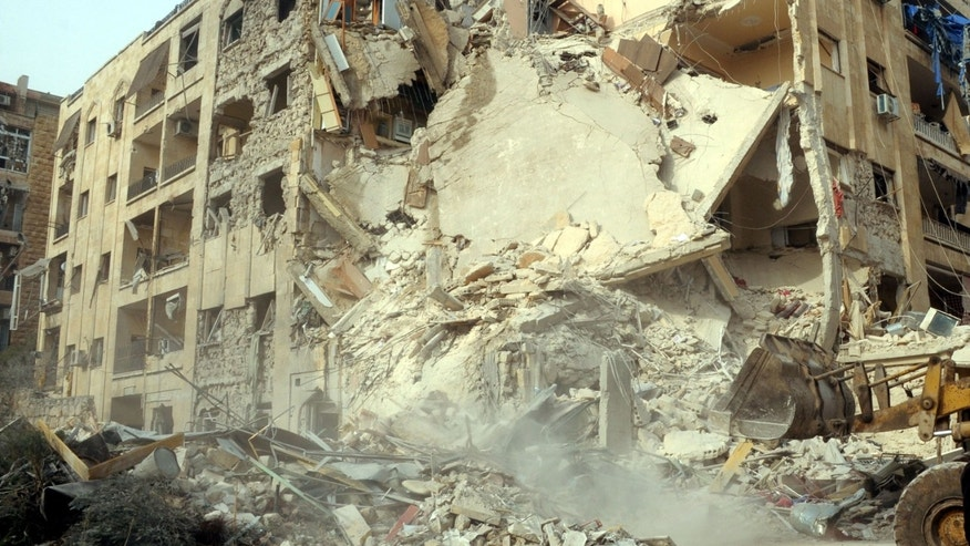 Jan. 18, 2013 -  Photo released by Syrian official news agency SANA, shows damage after a rocket slammed into a building, killing at least 12 people, in Aleppo, Syria.
