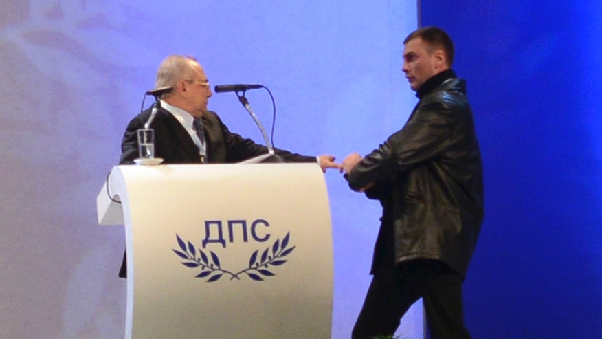 Jan. 19, 2013: An unidentified man (R) attacks Ahmed Dogan, leader of Bulgaria's Movement for Rights and Freedom (MRF) party, as he delivers his speech during his party's annual conference at the National Palace of Culture in Sofia.