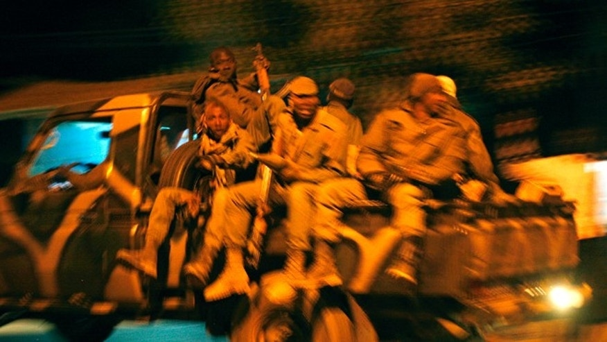 Jan. 19, 2013: Malian soldiers jubilate as they return to Niono, from Diabaly, some 300 miles north of the capital Bamako.