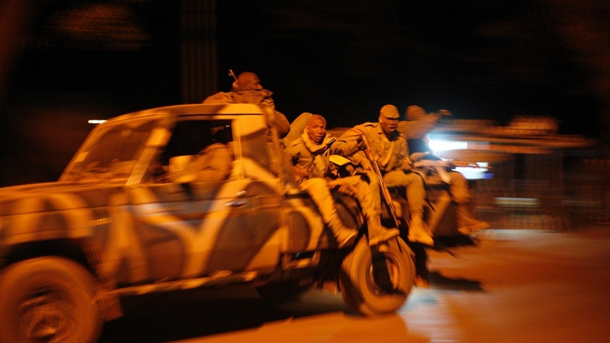 Malian soldiers jubilate as they return to Niono, from Diabaly, some 400 kms (300 miles) North of the capital Bamako, Saturday Jan. 19, 2013. French troops encircled a key Malian town on Friday, trying to stop radical Islamists from striking against communities closer to the capital and cutting off their supply line, a French official said. The move around Diabaly came as French and Malian authorities said that the city whose capture prompted the French military intervention in the first place was no longer in the hands of the extremists. (AP Photo/Jerome Delay)