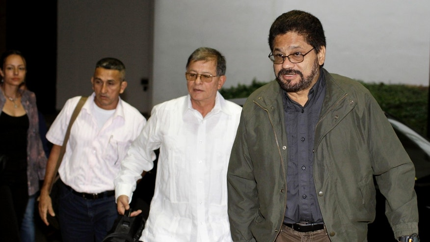 Ivan Marquez, right, chief negotiator for Colombia's Revolutionary Armed Forces of Colombia, or FARC, arrives with Ricardo Tellez, second from right, Ruben Zamora, third from right, and Dutch rebel Tanja Nijmeijer for the continuation of peace talks with Colombia's government in Havana, Cuba, Friday, Jan. 18, 2013. Talks began in October in Oslo, Norway and continued the following month in Havana. Several past efforts at peace have failed, though there is growing optimism both sides want to find common ground. (AP Photo/Franklin Reyes)