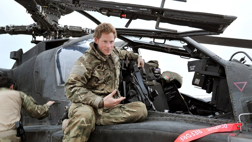 Dec. 12, 2012: Britain's Prince Harry talks to a TV crew after making his early morning pre-flight checks on the flight-line, from Camp Bastion southern Afghanistan.