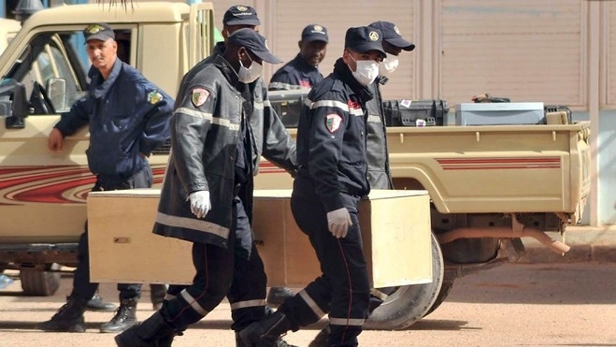 Jan. 21, 2013: Algerian firemen carry a coffin containing a person killed during the gas facility hostage situation at the morgue in Ain Amenas, Algeria.