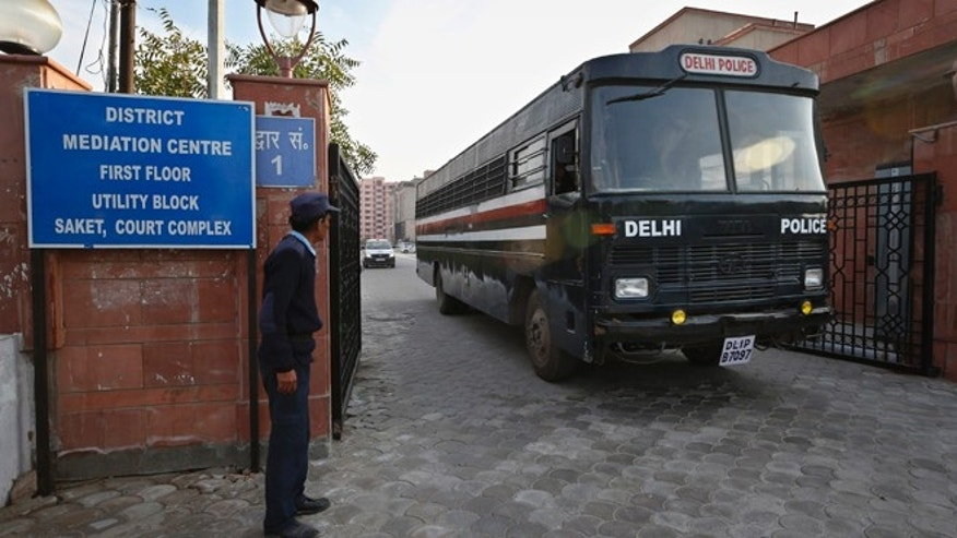 Jan. 21, 2013: A Delhi police van, believed to be carrying the five men facing charges that they raped and murdered a 23-year-old woman aboard a moving bus in the capital last month, comes out of a district court in New Delhi, India.