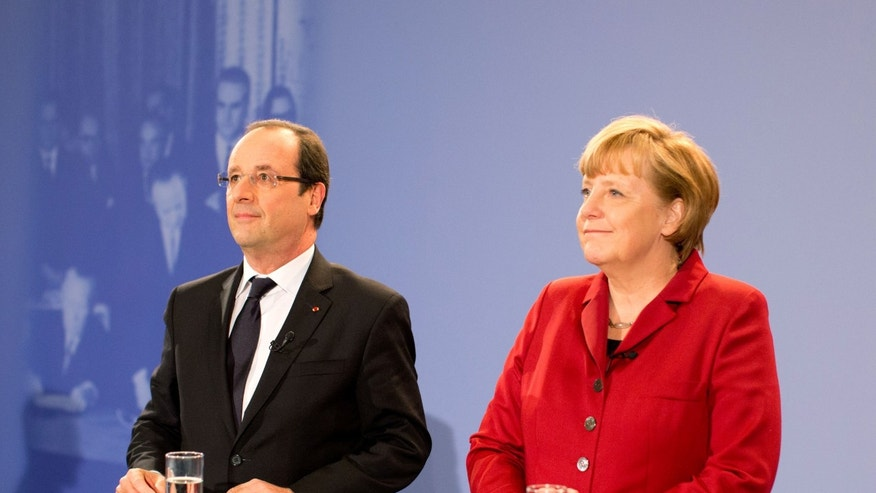 German Chancellor Angela Merkel, right, and President of France Francois Hollande attend a meeting with German and French students, trainees and young workers for a ceremony to mark the 50th anniversary of the Elysee Treaty at the Federal Chancellery in Berlin, Germany, Monday, Jan. 21, 2013. (AP Photo/Kay Nietfeld, Pool)