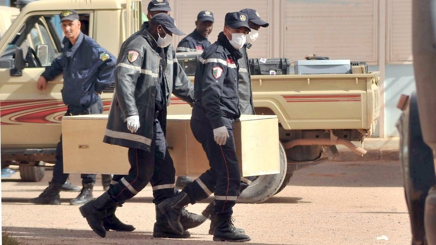 Algerian firemen carry a coffin containing a person killed during the gas facility hostage situation at the morgue in Ain Amenas, Algeria, Monday, Jan. 21, 2013. At least 81 people have been reported dead, including 32 Islamist militants, after a bloody, four-day hostage situation at Algeria's remote Ain Amenas natural gas plant. (AP Photo/Anis Belghoul)