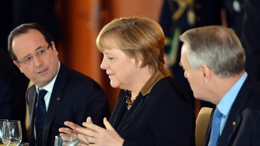 German Chancellor Angela Merkel, center, talks to French President Francois Hollande and French Prime Minister Jean-Marc Ayrault, right, during the French-German cabinet meeting in Berlin, Germany, Tuesday, Jan. 22, 2013, as part of the celebration to mark 50 years since the Elysee Treaty launched after WWII a French-German cooperation. (AP Photo/Odd Andersen, Pool)