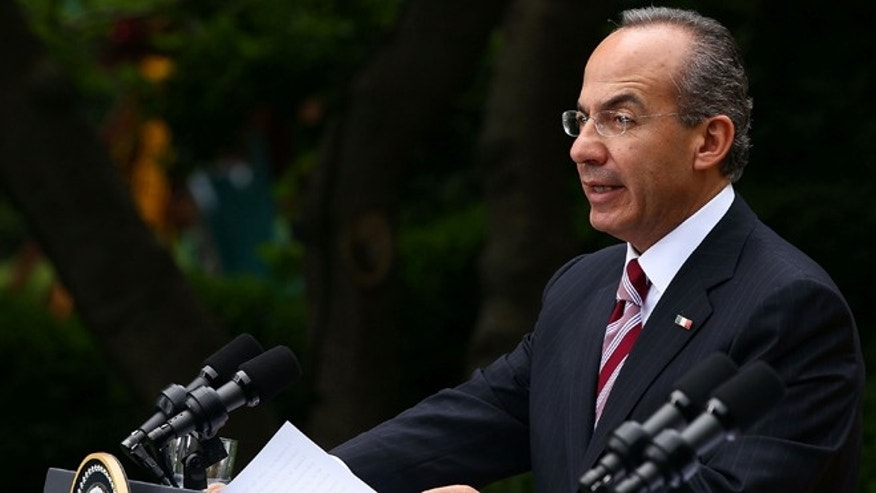 WASHINGTON - MAY 19:  Mexican President Felipe Calderon answers a question during a joint press conference with U.S. President Barack Obama in the Rose Garden of the White House during an official visit May 19, 2010 in Washington, DC. Calderon and Obama are were expected to talk about immigration policy, the drug war that has left thousands dead since Calderon became president in 2006 and trade between the two nation during a meeting in the Oval Office.  (Photo by Win McNamee/Getty Images)