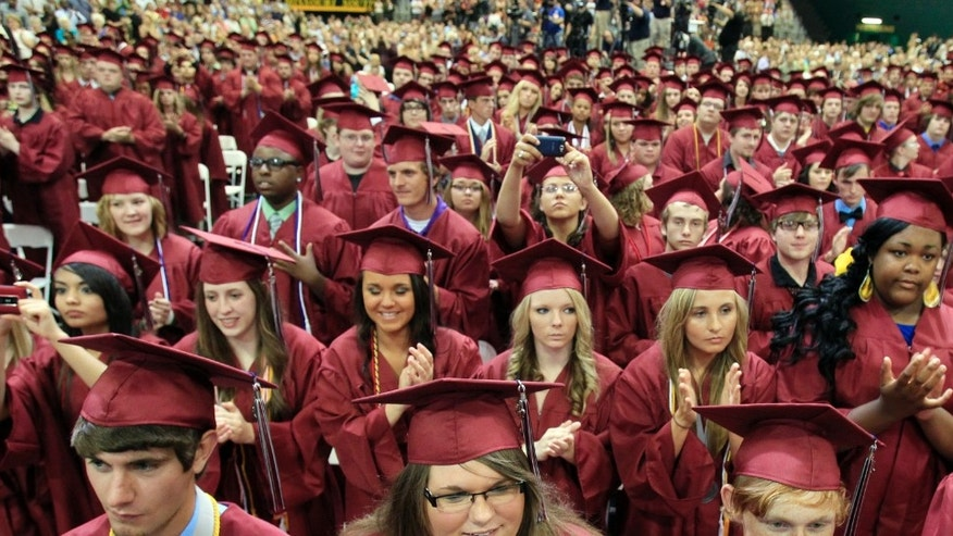 JOPLIN, MO - MAY 21:  Graduating seniors of Joplin High School applaud U.S. President Barack Obama after his speech Monday night during the Joplin High School Commencement Ceremony for the Class of 2012 at the Missouri Southern State University Leggett & Platt Athletic Center on May 21, 2012 in Joplin, Missouri. President Barack Obama spoke at the event in commemoration of the one year anniversary of the city being struck by an EF-5 tornado. (Photo by Rich Sugg-Pool/Getty Images)