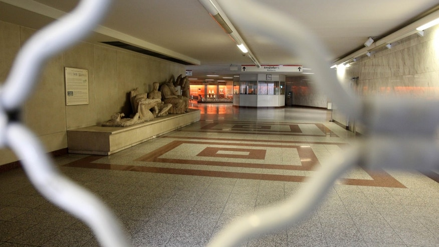 The Acropolis metro station is seen closed during a strike held by the unions of metro services in Athens, Monday, Jan. 21, 2013. Workers at the Athens metro system are striking for fifth day to protest salary cuts that are part of harsh austerity measures the country is taking to get its hands on bailout cash it needs to avoid bankruptcy. (AP Photo/Thanassis Stavrakis)