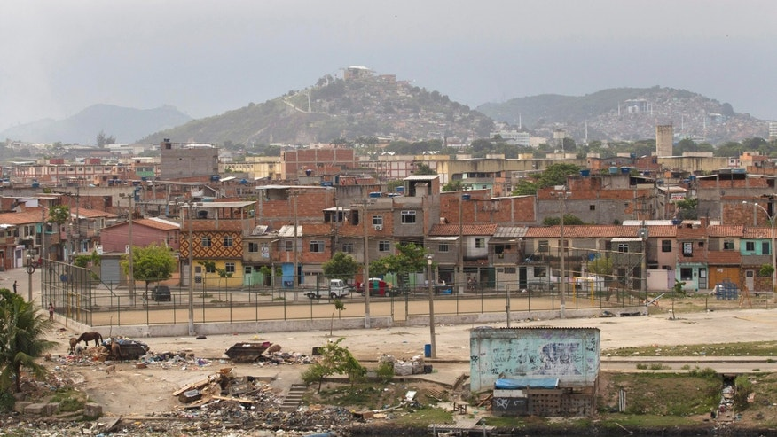 This Dec. 28, 2012 photo shows the Mare shantytown in Rio de Janeiro, Brazil. The cityís densest neighborhoods, its favelas, or shantytowns blanket entire hillsides. providing most of the cityís affordable housing. Government officials have traditionally considered them eyesores and literally left them off the map, condemning millions to legal invisibility. Now, those communities are being charted after decades of informality, each route and alley outlined and their names researched. (AP Photo/Silvia Izquierdo)