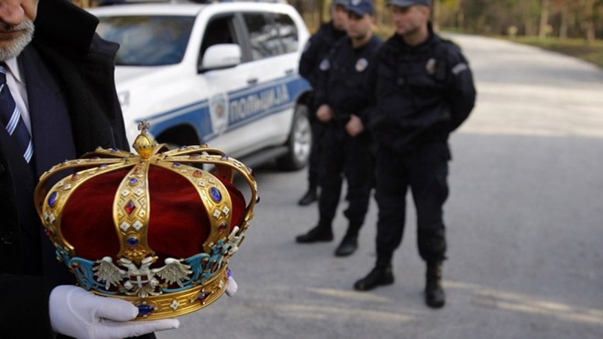 Jan. 22, 2013: A man carries a crown of Peter II Karadjordjevic during a solemn ceremony after the remains of Yugoslavia's last king were flown back to Serbia in Belgrade, Serbia.