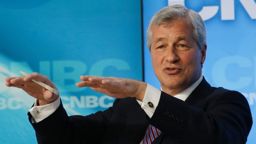 James Dimon of the U.S., chairman and chief executive officer of JP Morgan gestures during the Global Financial Context session at the 43rd Annual Meeting of the World Economic Forum, WEF, in Davos, Switzerland, Wednesday, Jan. 23, 2013.  (AP Photo/Anja Niedringhaus)