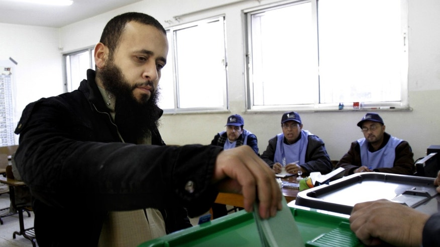 A Jordanian man casts his ballot inside a polling station in Amman, Jordan, Wednesday, Jan. 23, 2013.  Jordan's monarchy has touted Wednesday's parliamentary election as a watershed in the kingdom's democratization. It is the first after last year's constitutional amendments that see King Abdullah II gradually relinquishing much of his powers in running the daily affairs of the state to the legislature, although he will continue for now to set broader foreign and security policies. (AP Photo/Raad Adayleh)