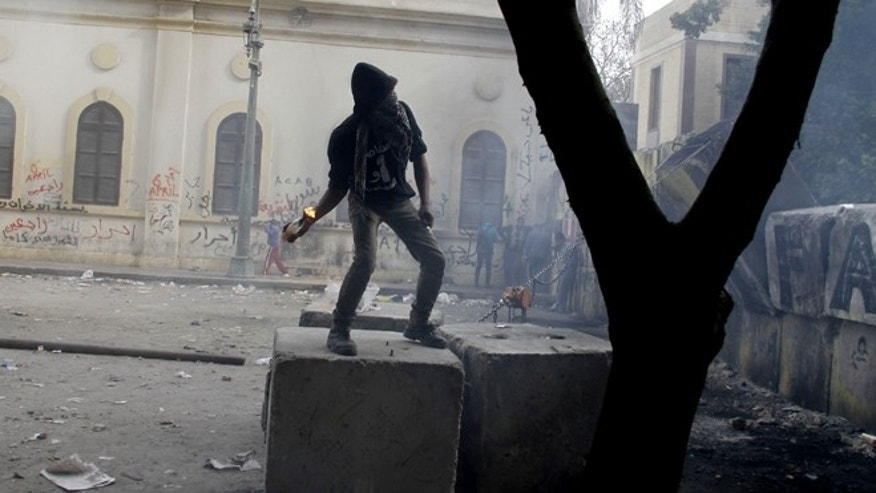 Jan. 24, 2013: A Protester moments before throwing a Molotov cocktail toward Egyptian riot police, unseen, near Tahrir Square in Cairo, Egypt.