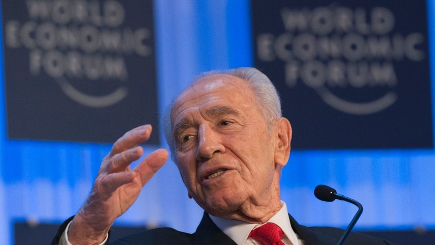 Israel's President, Shimon Peres, gestures as he speaks  during  the 43rd Annual Meeting of the World Economic Forum, WEF, in Davos, Switzerland, Thursday, Jan. 24, 2013. (AP Photo/Michel Euler)