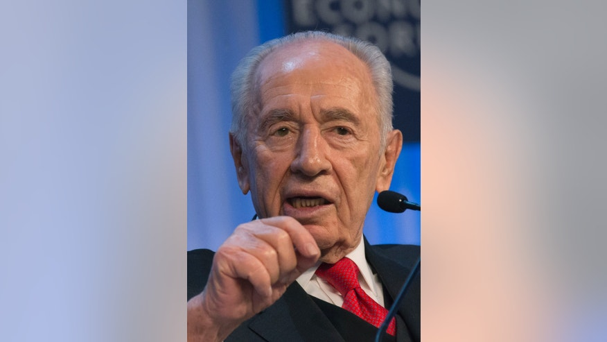 Israel's President, Shimon Peres, gestures as he speaks at  the 43rd Annual Meeting of the World Economic Forum, WEF, in Davos, Switzerland, Thursday, Jan. 24, 2013. (AP Photo/Michel Euler)