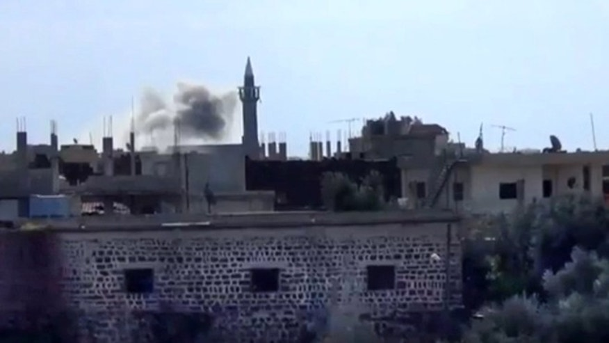 Jan. 24, 2013: In this image taken from video obtained from the Shaam News Network, which has been authenticated based on its contents and other AP reporting, smoke rises from buildings due to heavy shelling in Daraa, Syria.