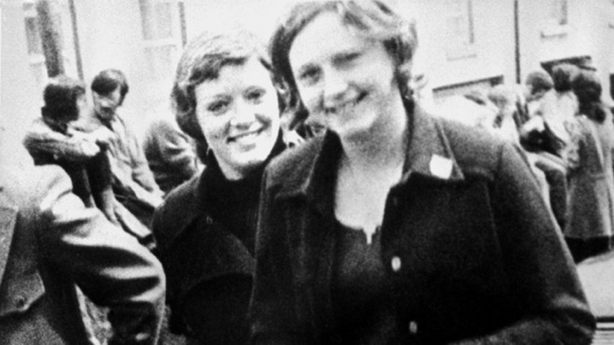 In this file photo dated June 4, 1972 Dolours Price, left, and her sister Marian attend a civil rights demonstration in Belfast, Northern Ireland. Police say Dolours Price, a veteran Irish Republican Army member at the center of allegations against Sinn Fein leader Gerry Adams has been found dead at her home. Dolours Price had alleged that Adams was her IRA commander in Belfast in the early 1970s and was involved in ordering several Catholic civilians to be abducted, executed and buried in secret.