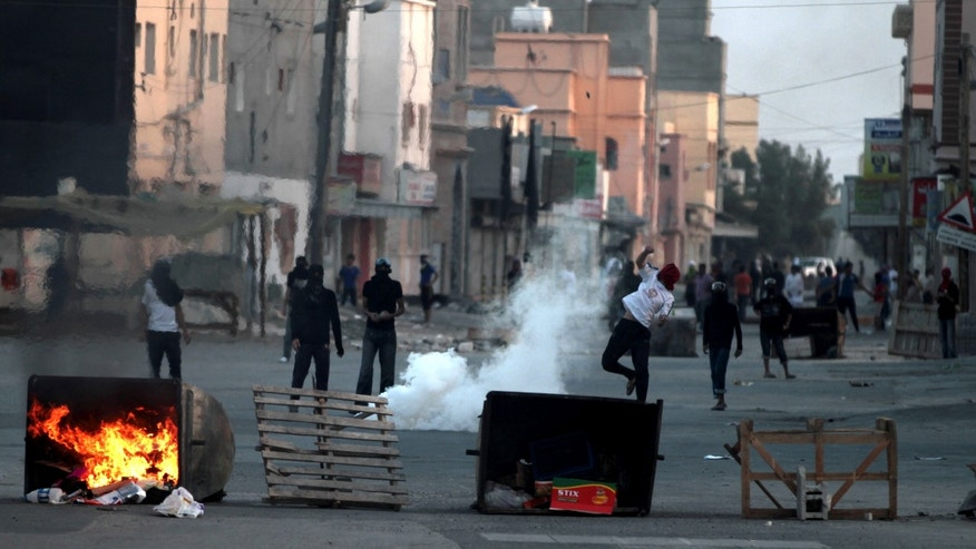 Bahraini anti-government protesters clash with riot police in Ma'ameer, Bahrain, Thursday, Jan. 24, 2013, in Ma'ameer, Bahrain. Riot police in Bahrain fired tear gas and stun grenades at anti-government protesters whose chants included calls to reject proposed talks aimed at easing nearly two years of unrest in the Gulf nation. (AP Photo/Hasan Jamali)