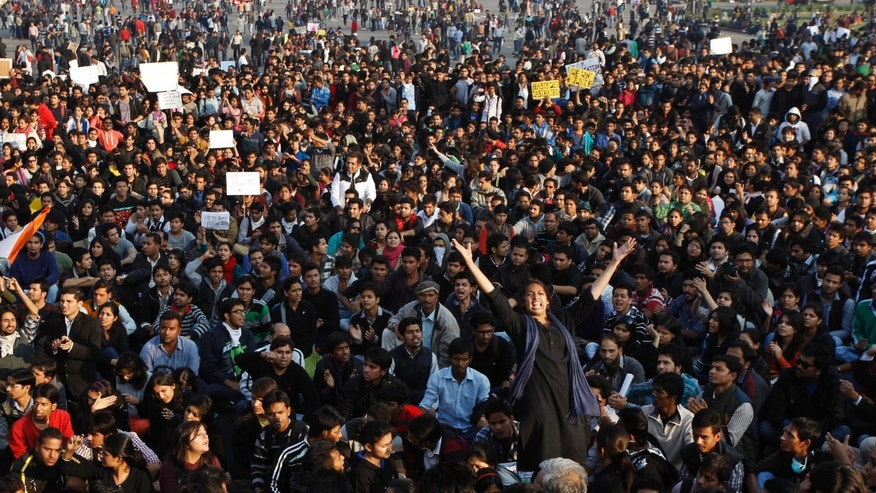 FILE - In this Saturday, Dec. 22, 2012 file photo, an Indian woman stands and shouts slogans as she participates in a protest against the gang rape of a 23-year-old student on a moving bus in New Delhi, India. In the court of public opinion, the men being tried in the gang rape of the Indian university student should be hanged in a public square. The demand for swift justice might make it impossible for them to get a fair trial in a court of law, with even a local bar association stopping its members from representing the men citing the heinous nature of the crime. (AP Photo/Tsering Topgyal, File)