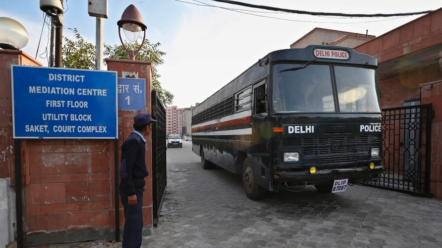 FILE - In this Monday, Jan. 21, 2013 file photo, a Delhi police van, believed to be carrying the five men facing charges that they raped and murdered a 23-year-old woman aboard a moving bus in the capital last month, comes out of a district court in New Delhi, India. In the court of public opinion, the men being tried in the gang rape of the Indian university student should be hanged in a public square. (AP Photo/ Saurabh Das, File)