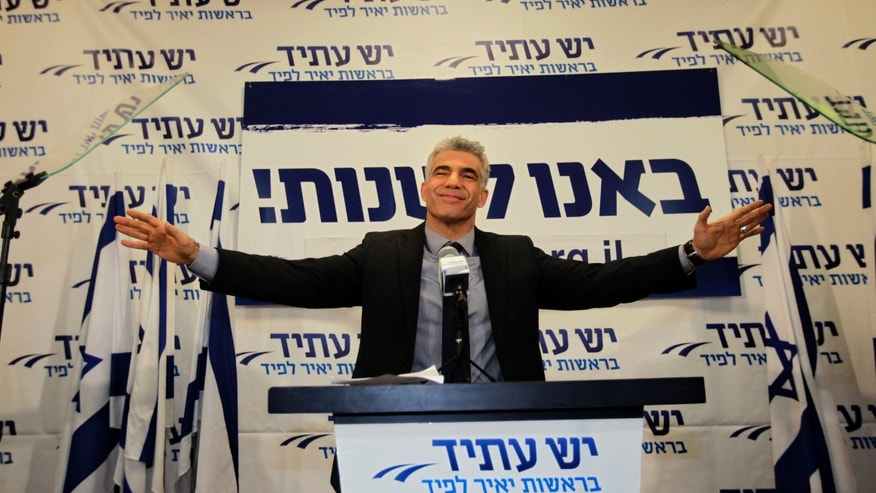 "In this Wednesday, Jan. 23, 2013 photo, Yair Lapid gestures as he delivers a speech at  his ""Yesh Atid"" party in Tel-Aviv. The party, formed just over a year ago, out did forecasts by far and are predicted to capture as many as 19 seats, becoming parliament's second-largest party, after Netanyahu's Likud-Beiteinu bloc, which won 31, according to the exit polls. (AP Photo/Sebastian Scheiner)"