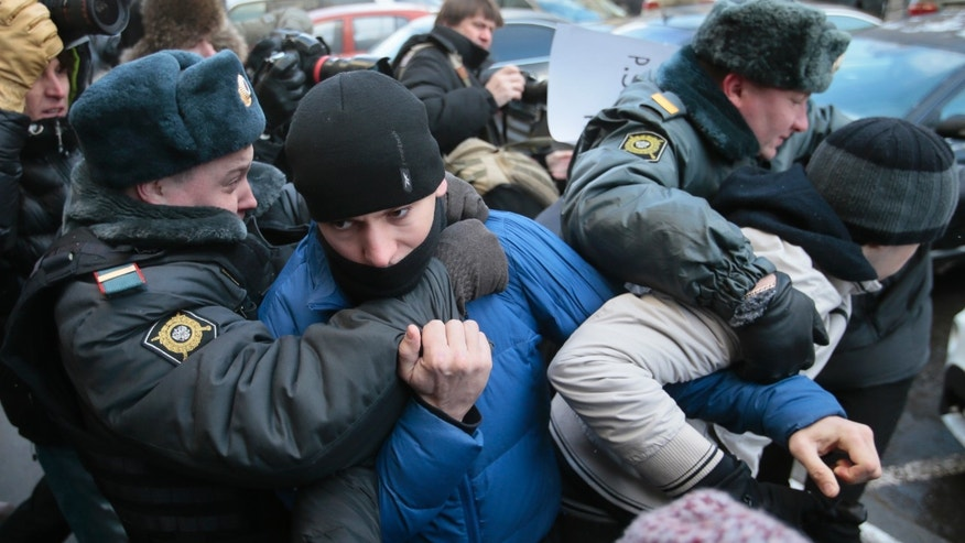 "Police detain supporters of a bill banning ""homosexual propaganda"" near the State Duma, Russia's lower parliament chamber, in Moscow, Russia, Friday, Jan. 25, 2013. A controversial bill banning ""homosexual propaganda"" has been submitted to Russia's lower house of parliament for the first of three hearings on Friday. Twenty people were detained according to a police report. (AP Photo/Mikhail Metzel)"