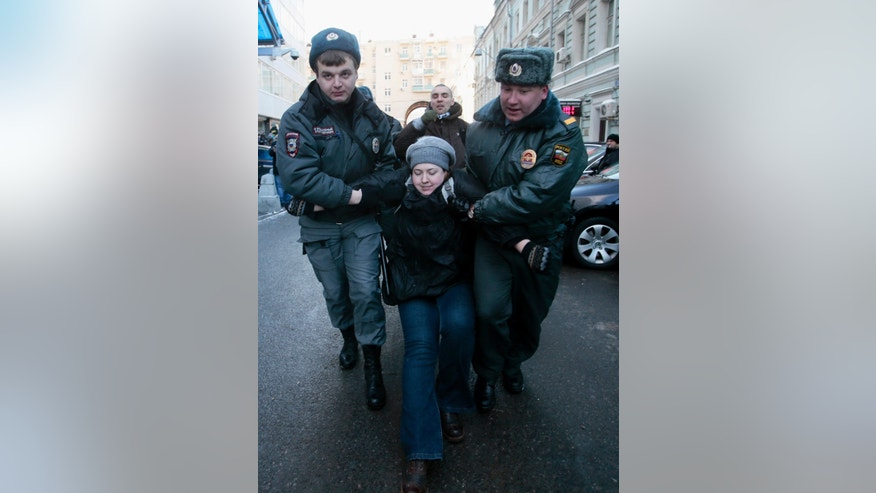 "Police detain a gay rights activist during a protest near the State Duma, Russia's lower parliament chamber, in Moscow, Russia, Friday, Jan. 25, 2013. A controversial bill banning ""homosexual propaganda"" has been submitted to Russia's lower house of parliament for the first of three hearings on Friday. Twenty people were detained according to a police report. (AP Photo/Mikhail Metzel)"
