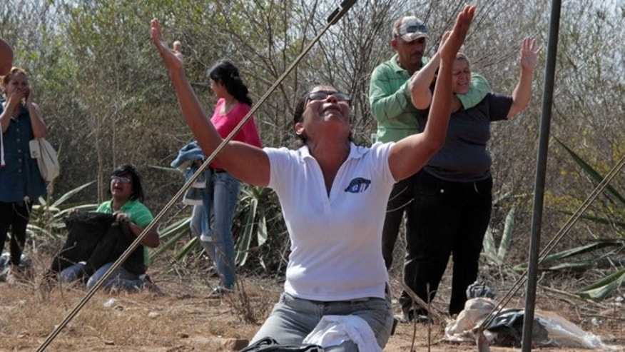 Jan. 25, 2013: Relatives of inmates react outside the Uribana prison in Barquisimeto, Venezuela.