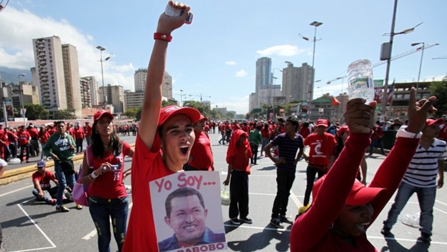 Jan. 26, 2013: Supporters of Venezuela's President Hugo Chavez shout slogans during a rally in Caracas, Venezuela.