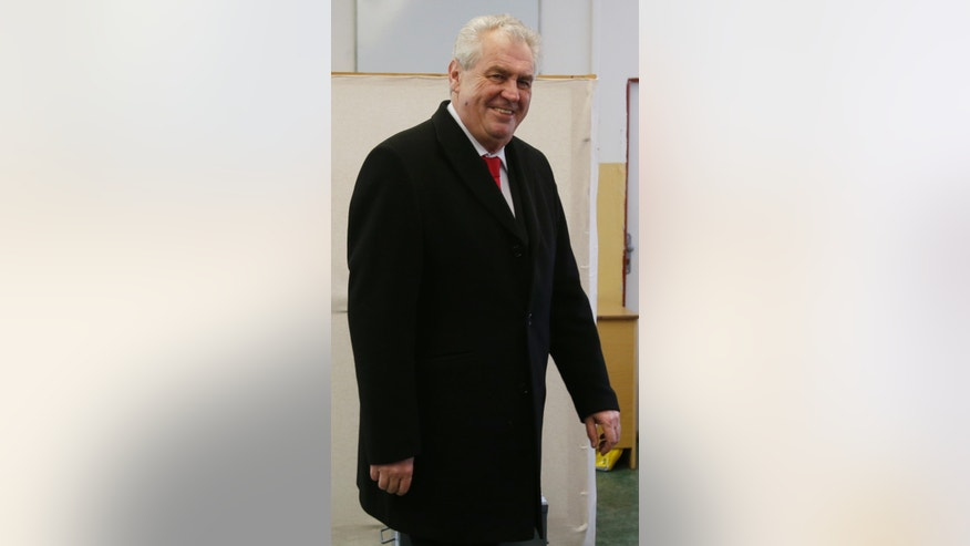 Presidential candidate Milos Zeman smiles after casting his vote during second round of Presidential elections in Prague, Czech Republic, Friday, Jan. 25, 2013. (AP Photo/Petr David Josek)