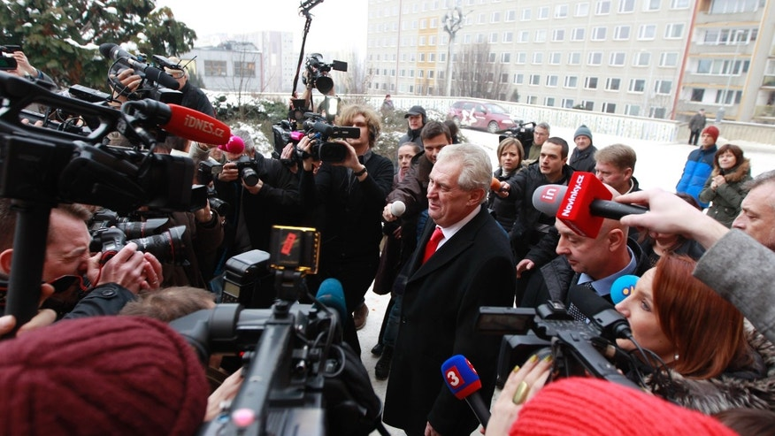 Presidential candidate Milos Zeman,  is surrounded by media,as he  leaves the polling station after casting his vote during second round of Presidential elections in Prague, Czech Republic, Friday, Jan. 25, 2013. (AP Photo/Petr David Josek)