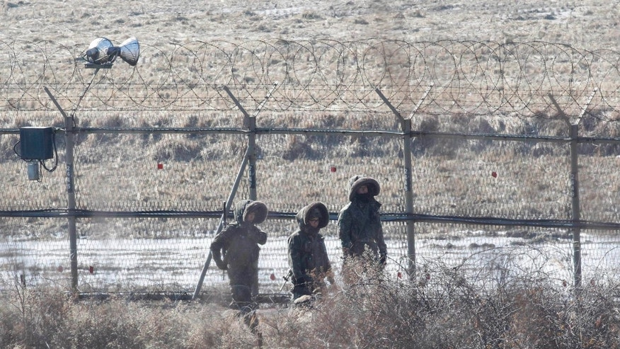 South Korean army soldiers patrol along the barbed-wire fence at the Imjingak Pavilion, South Korea, near the demilitarized zone (DMZ) of Panmunjom, Saturday, Jan. 26, 2013. Following new U.N. sanctions punishing North Korea for a December rocket launch, North Korea warned that it would continue launching long-range rockets and conduct a nuclear test. (AP Photo/Ahn Young-joon)