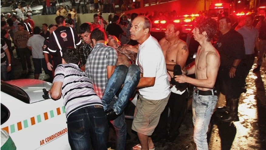 Jan. 27, 2013: A victim of a fire in a club is carried in Santa Maria city, Rio Grande do Sul state,  Brazil.