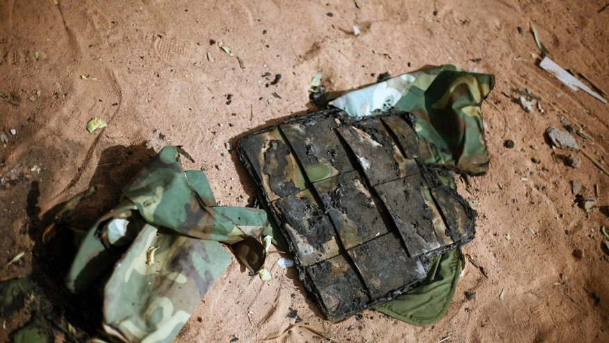 In this image taken during an official visit organized by the Malian army to the town of Konna, some 680 kilometers (430 miles) north of Mali's capital Bamako, Saturday, Jan. 26, 2013, a charred flack jacket lays on the ground of a destroyed base used by islamist rebels.  One wing of Mali's Ansar Dine rebel group has split off to create its own movement, saying that they want to negotiate a solution to the crisis in Mali, in a declaration that indicates at least some of the members of the al-Qaida linked group are searching for a way out of the extremist movement in the wake of French air strikes. (AP Photo/Jerome Delay)