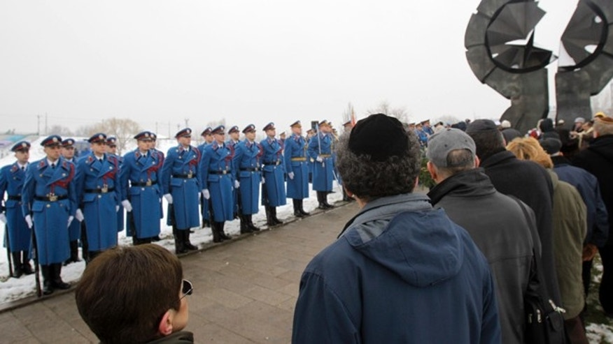 Jan. 27, 2013: Serbian military honor guards stand to attention as people attend commemorations for victims of the Holocaust at a monument erected in the former World War II Nazi concentration camp of Sajmiste in Belgrade, Serbia.