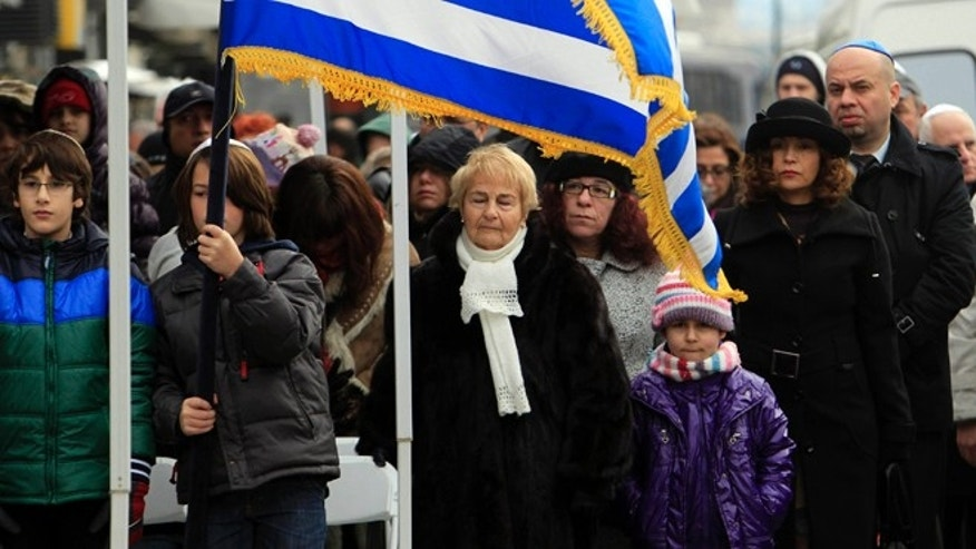 Jan. 27, 2013: People attend a  ceremony at the Holocaust Memorial commemorating the persecution of the Jewish people during World War II, in Thessaloniki, northern Greece. There were around 50,000 Jews living in Thessaloniki at the start of World War II, and almost 45,000 perished at Auschwitz concentration camp, and Greece officially commemorates the Holocaust every Jan. 27.